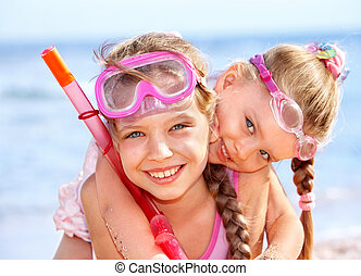Children playing on beach Snorkeling