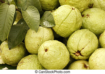 Guavas and leaves displayed to attract buyers