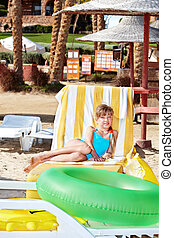 Child sitting on inflatable ring - Children sitting on...