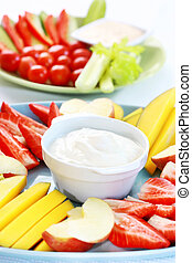 Raw fruits and vegetables with dip - Raw fruits and...