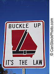 Buckle up Georgia - road sign seen on the highway