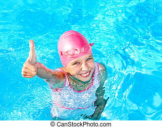 Thumb up of kid in swimming pool. - Thumb up of child in...