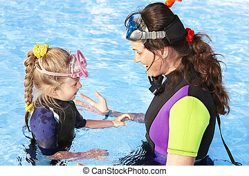 Child with mother in swimming pool . - Child with mother in...