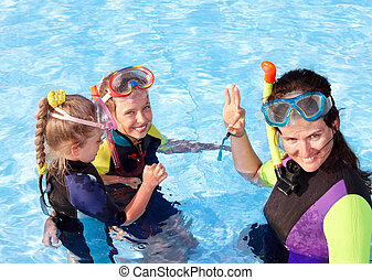 Children in swimming pool learning snorkeling. Sport.