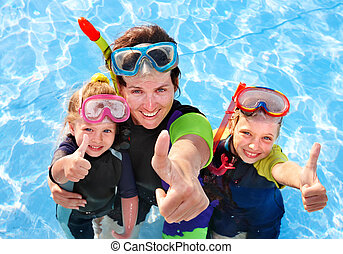 Children with mother in swimming pool - Children with mother...