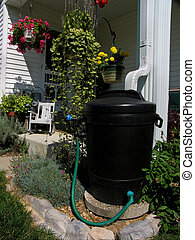 Rainbarrel in Flower Garden - A rainbarrel made from an old...