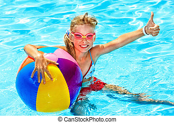 Child swimming in pool - Little girl swimming in pool