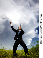man in the black suit and holding megaphone shouting to the storm