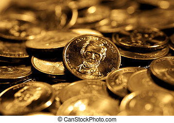 Gold Coins - A pile of golden goins representing wealth and...