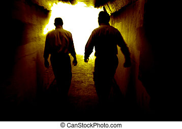 Walking to the Light - Two people walking through a tunnel...