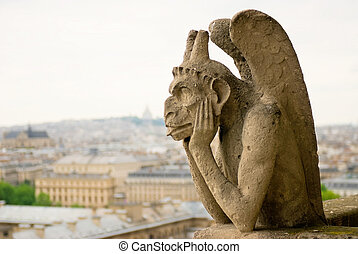 Gargoyle on a background a hill Montmartre - Chimera on...
