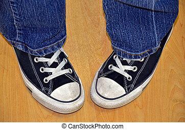 pair of sneakers - Pigeon-toed teen wearing sneakers.