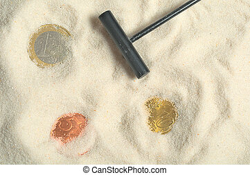 Finding treasure with euros in the sand
