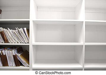 File Folders on Shelf - Shelf full of folders and files in...