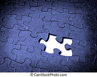 Puzzle Together - Closeup of grainy puzzle pieces with one...