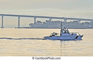 Dawn Patrol - A Coast Guard Patrol Boat motors out into the...