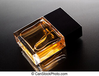 Perfume bottle on a black backdrop