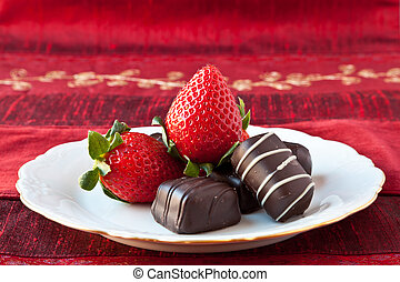Strawberries and Chocolates on a Plate - Dark chocolate...