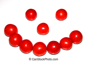 Smiling ugly face from little tomatoes
