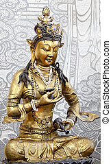 Golden Kuan Yin - Statue of Golden Kuan Yin with stone...