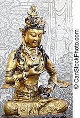Golden Kuan Yin - Statue of Golden Kuan Yin with stone...