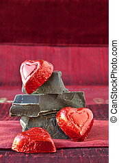 Candy Hearts on a Pile of Dark Chocolate Pieces - Red foil...
