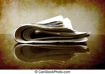 Newspaper Rolled Up - Rolled up newspaper isolated on white...
