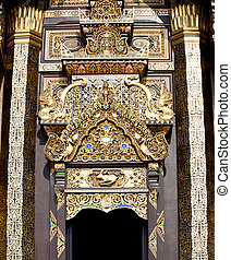 Traditional door and frame in thai architecture in the Lanna style , Royal Pavilion (Ho Kum Luang) at Royal Flora Ex