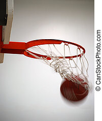 Basketball Shot - Basketball going into hoop and net with...