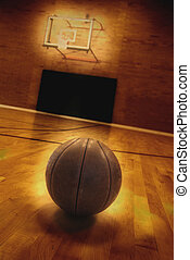 Basketball and Basketball Court - Basketball on floor of...