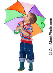 Little boy with umbrella, looking up