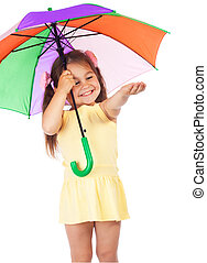 Little girl with umbrella, checking for rain