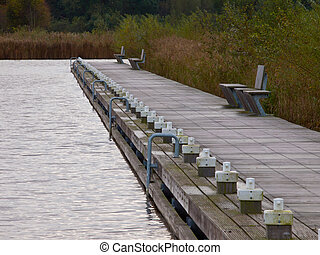 A modern wooden jetty with bench