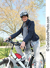 Woman having bike ride