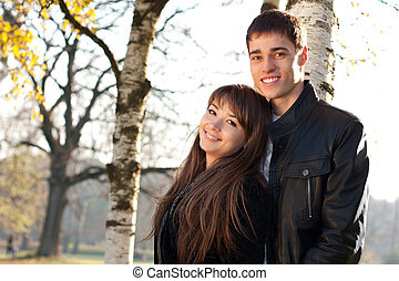 Young beautiful happy couple in love in outdoors
