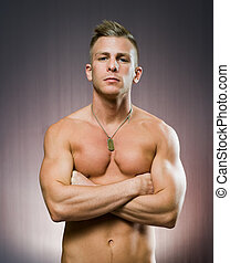 Your personal trainer, portrait of a very fit handsome young...