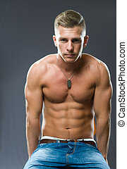 Super fit. - Portrait of a very fit, ripped young man...