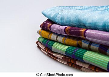 Folded Sarong on White - Folded sarong and traditional Malay...