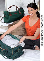 Woman packing her bags