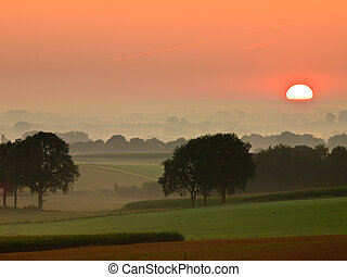 Red sunrise over rural countryside