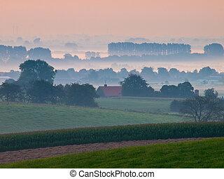 Sunrise over dutch rural hills