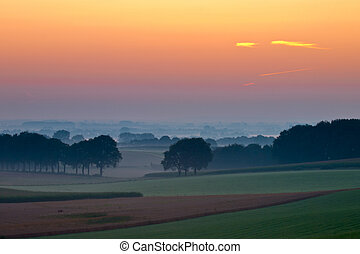 Magical sunrise over hillside agricultural country