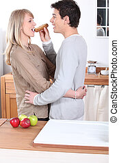Couple eating an eclair