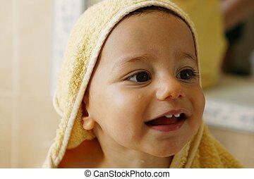 baby boy taking a bath