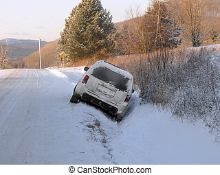 In the ditch - Sports utility vehicle in the ditch due to...