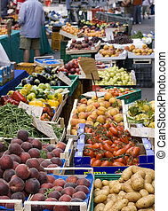 Fruits at marketplace - Peaches, plum and other fruits at...