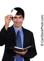 Executive with a blank businesscard and diary