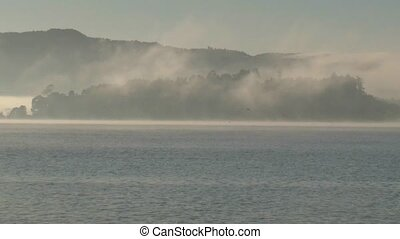 Lake Rotorua thermal mist - Early morning mist over lake...