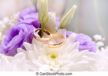 wedding rings ans flower - abstract scene with wedding rings...