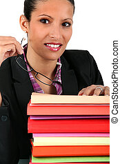 businesswoman with a pile of folders